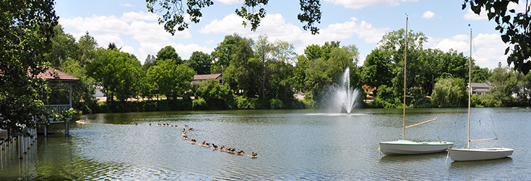 scenic shot of Lake Lisgar with gazebo and fountain
