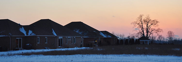 winter sunset with homes and field