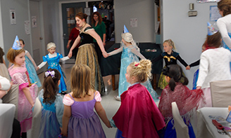 little girls at Frozen party in the museum program room