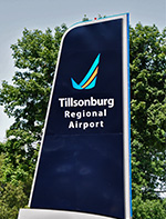 tillsonburg regional airport sign shaped like tailwing