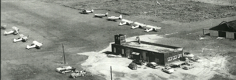 aerial of tillsonburg airport in 1950s with terminal and aircraft