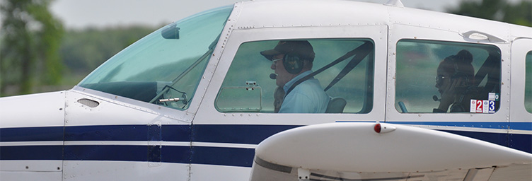 pilot and passengers in plane wearing headsets