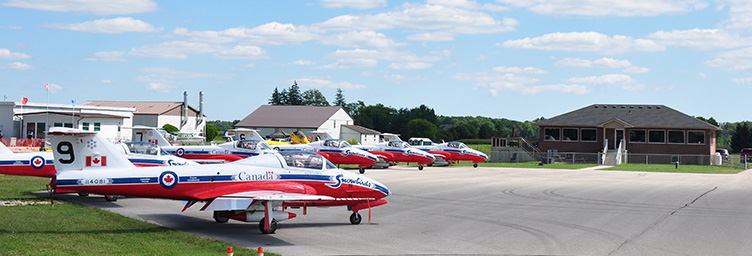tillsonburg terminal building with harvards on apron in front