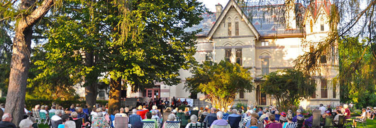 lawnchairs gathered on lawn at Annandale for evening concert