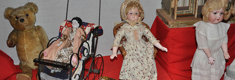 collection of antique dolls and bears
