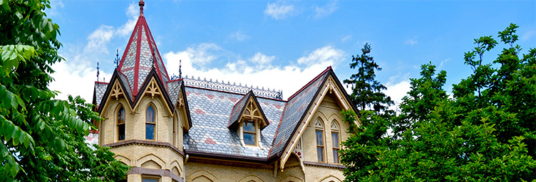 roofline of Annandale with blue sky and clouds