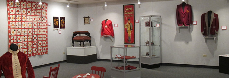 various objects on display that are all ruby coloured