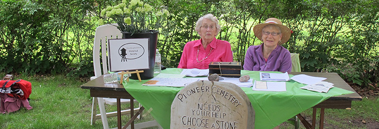 members of the historical society collecting donations