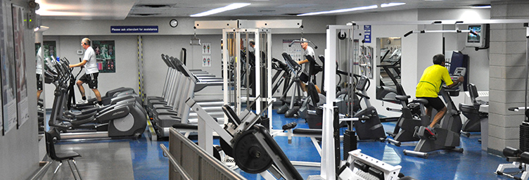 health club equipment with patrons working out
