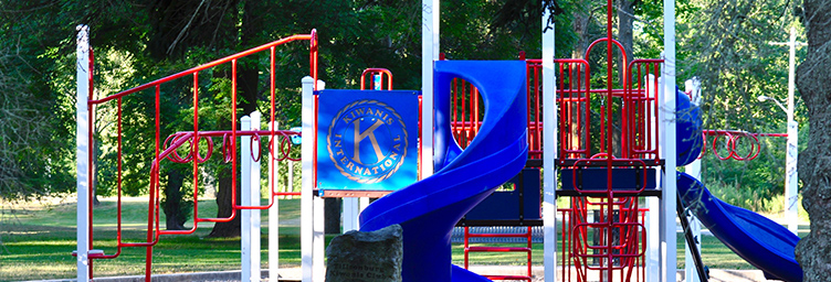 playground equipment with the Kiwanis Club logo