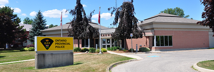 opp station in Tillsonburg with sign and flag poles