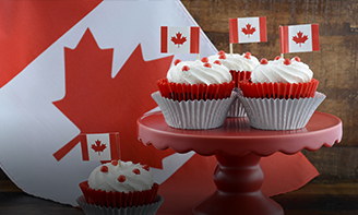 cupcakes decorated with Canadian flags